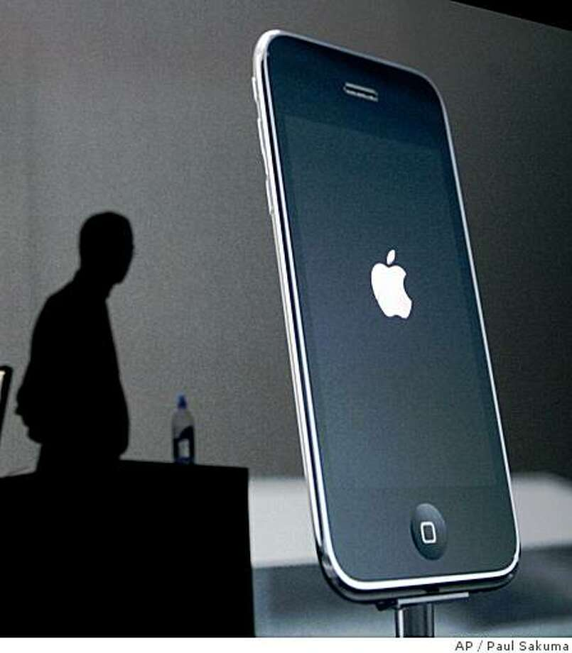 Apple CEO Steve Jobs announces the new Apple 3G iPhone at the Apple Worldwide Developers Conference in San Francisco, Monday, June 9, 2008. (AP Photo/Paul Sakuma) Photo: Paul Sakuma, AP