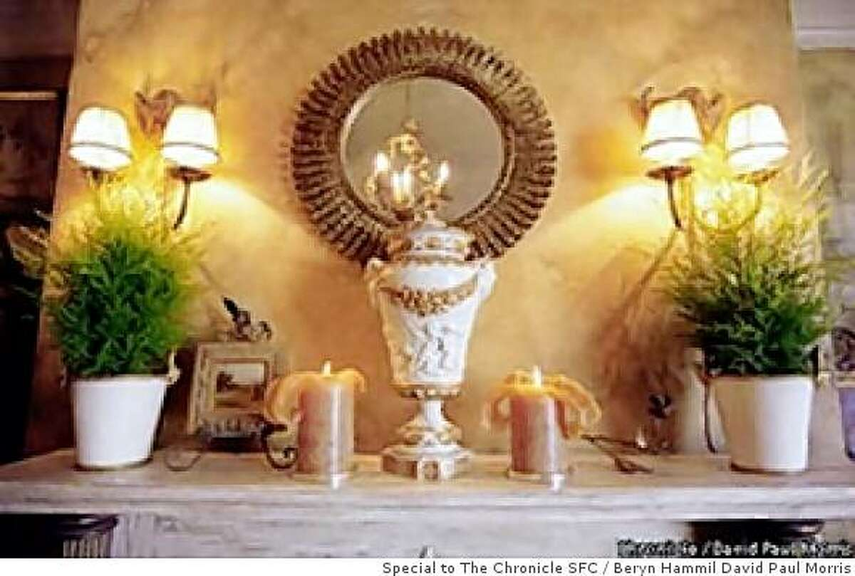 No matter the budget, elegance is achieved with an eye for balance -- and sometimes a pair of plants in simple pots.STYLEc-C-20SEPT00-HM-DPM-Detail of the fireplace mantle. Chronicle photo by David Paul Morris