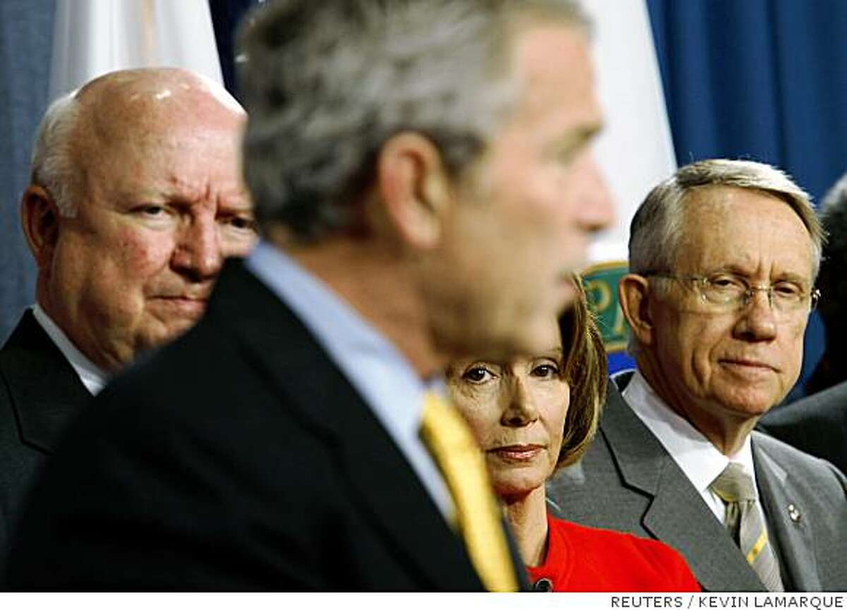 .S. President George W. Bush speaks during a signing ceremony for the Energy Independence and Security Act of 2007 at the U.S. Department of Energy in Washington, December 19, 2007. Listening to Bush (L-R) is Energy Secretary Sam Bodman, Speaker of the House Nancy Pelosi (D-CA) and Senate Majority Leader Harry Reid (D-NV). REUTERS/Kevin Lamarque (UNITED STATES) Ran on: 12-20-2007
