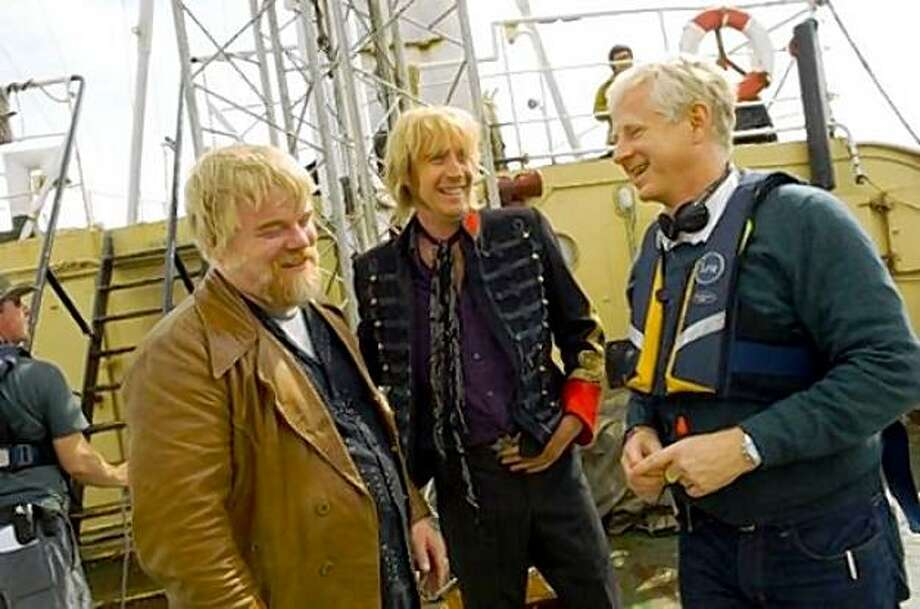 "Philip Seymour Hoffman and Rhys Ifans talk with director Richard Curtis on the set of ""Pirate Radio."" Photo: Courtesy Ben Fong-Torres"