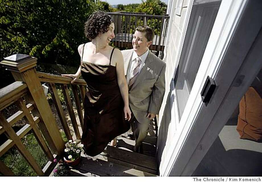 Rachel Lanzerotti, left, and Carol Cantwell walk up the back steps of their Bernal Heights home as they prepare for their marriage ceremony at San Francisco City Hall. Chronicle photo by Kim Komenich Photo: Kim Komenich, The Chronicle