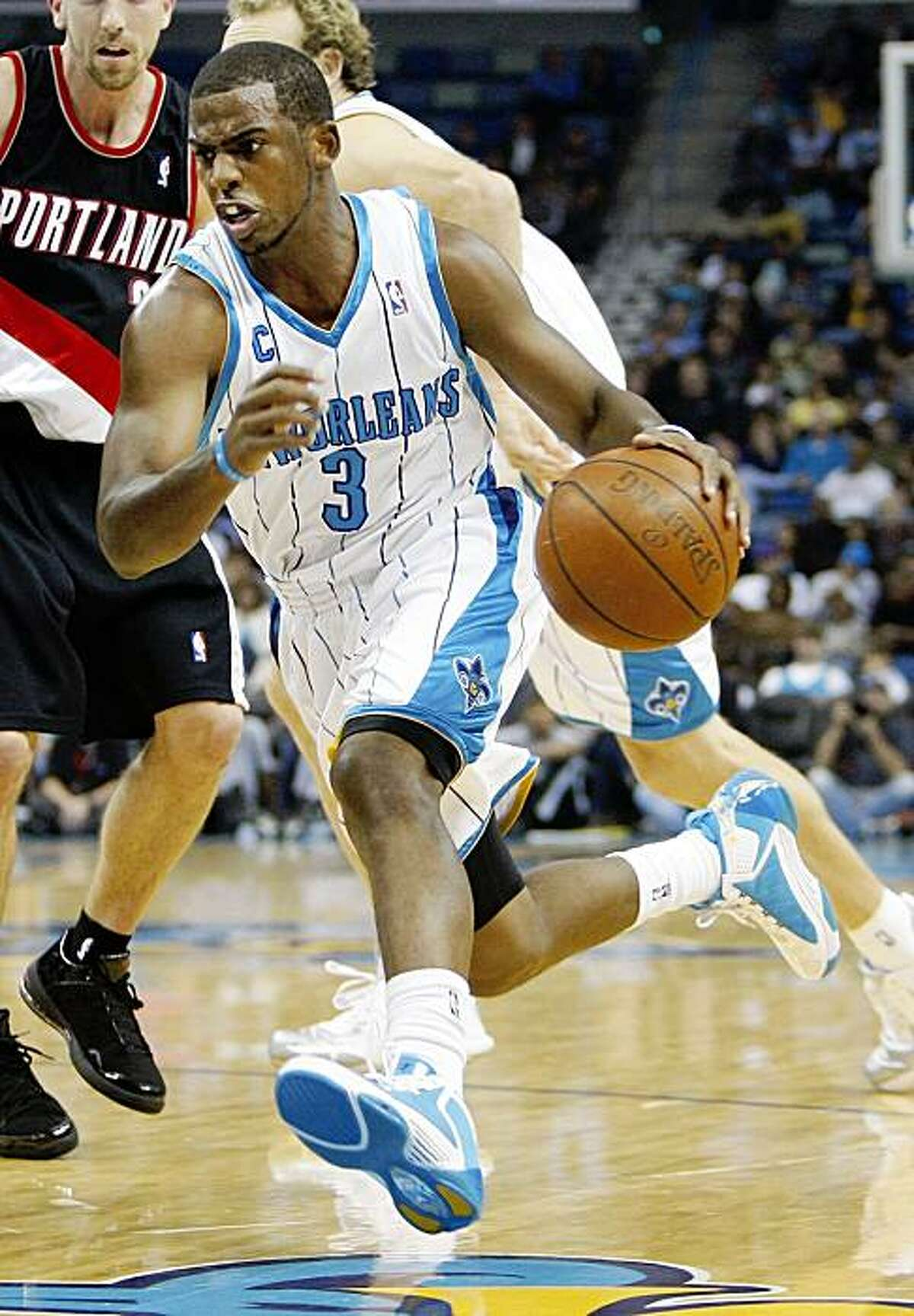 New Orleans Hornets guard Chris Paul (3) drives to the basket in the first half against the Portland Trail Blazers in an NBA basketball game in New Orleans, Friday, Nov. 13, 2009. (AP Photo/Bill Haber)