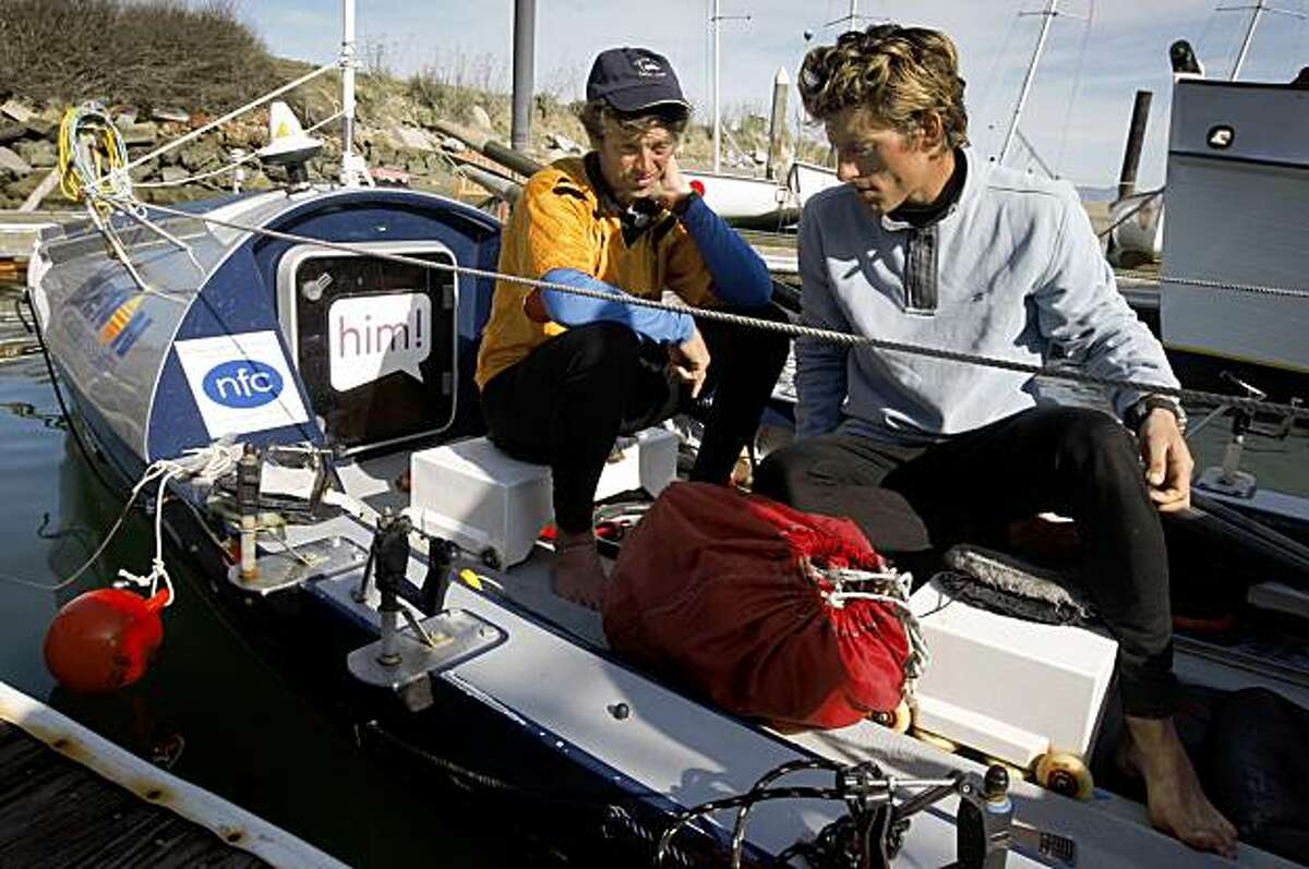 """Mick Dawson (left) and Chris Martin rest on board the """"Bojangles"""" at the Golden Gate Yacht Club after the British pair rowed the high-tech boat across the northern Pacific Ocean and arrived in San Francisco, Calif., on Friday, Nov. 13, 2009. The two set out on their adventure from Japan in May."""