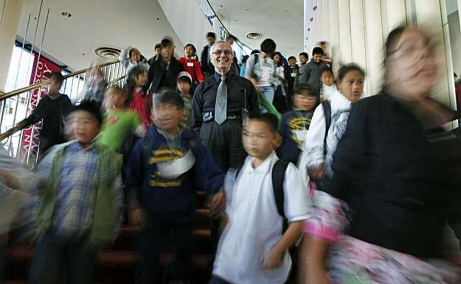 Horacio Rodriguez is celebrating his 50th anniversary as an usher at Davies Symphony Hall in San Francisco as he guides school children to their seats during an afternoon concert Thursday November 19, 2009 Photo: Lance Iversen, The Chronicle