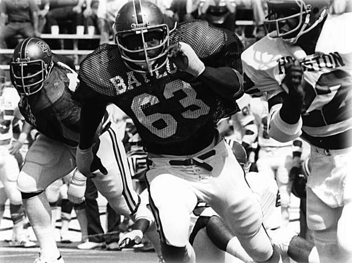 WACO, TX - 1978: Mike Singletary #63 of the Baylor University Bears tries to tackle a player from the Houston Cougars circa 1978 at Floyd Casey Stadium in Waco, Texas.