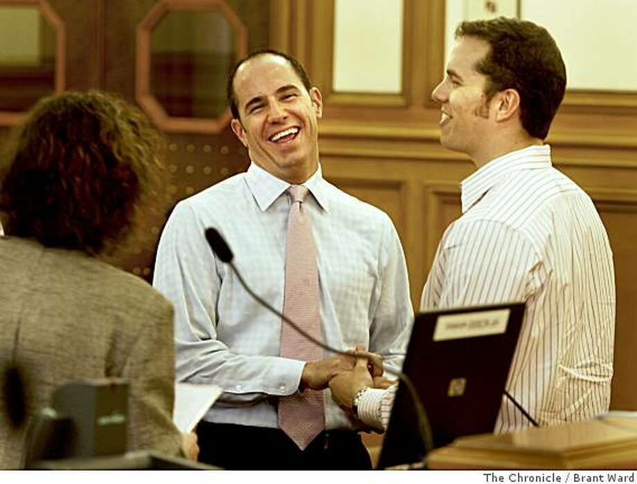 Jason Hinson, left, and Luke Klipp enjoyed a light moment during a mock wedding held by Amy Brown. Hundreds of San Francisco, Calif. city employees are getting deputized this week to work on and perform the thousands of weddings expected at City Hall next week. A training session was held Thursday, June 12, 2007  By Brant Ward / The Chronicle Photo: Brant Ward, The Chronicle