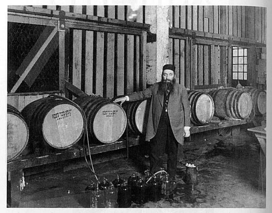 "from the book ""cosmopolitans"" by fred rosenbaum:  rabbi Mayer Hirsch of congregation Anshe Sfard. During prohibition many traditional synagogues generated income through sale of ""sacramental"" wine, which authorities permitted Photo: Judah L. Magnes Museum"