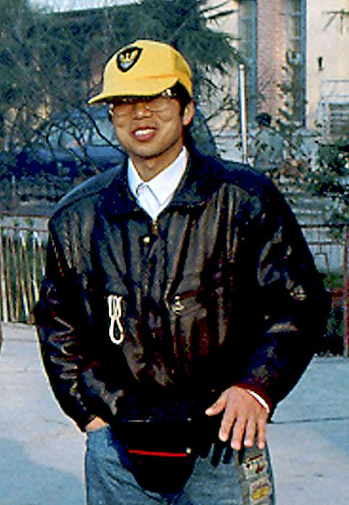 In this photo released by David Rowley, taken Dec. 7, 1993 and made available Thursday, Nov 19, 2009, Feng Xue poses for photos in Yuexi, Anhui Province. Xue was been detained for two years by Chinese police on state secrets charges over the purchase of a commercial database on the oil industry. (AP Photo/David Rowley)