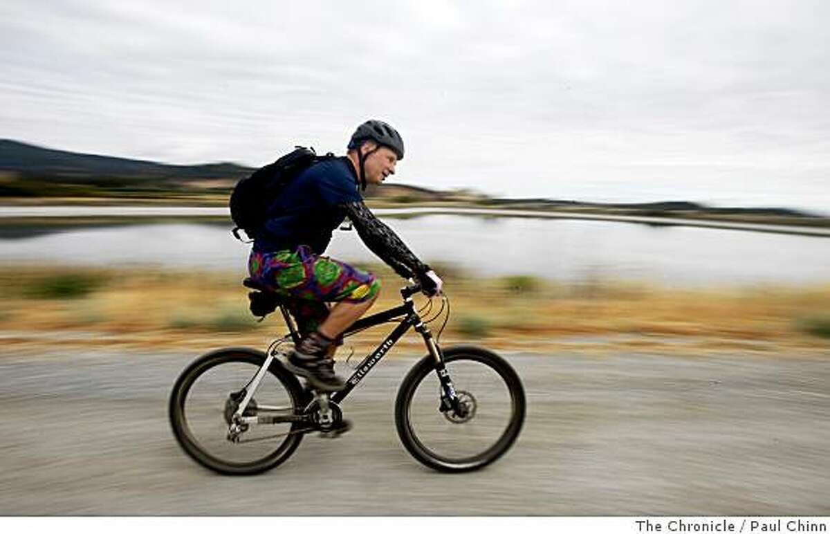 Eric Sayetta rides past Las Galinas Marsh in San Rafael, Calif., while commuting to his job in Novato on the Bay Trail on Wednesday, May 28, 2008. Sayetta leaves his car at home and now makes the three-hour round trip commute on his mountain bike.
