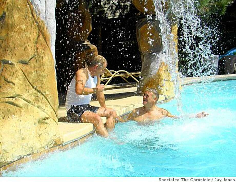 Tourists Andy Steele, left, and his partner, Michael Turner, lounge by the pool at the Blue Moon Resort, Las Vegas� only exclusively gay hotel. Photo: Jay Jones, Special To The Chronicle