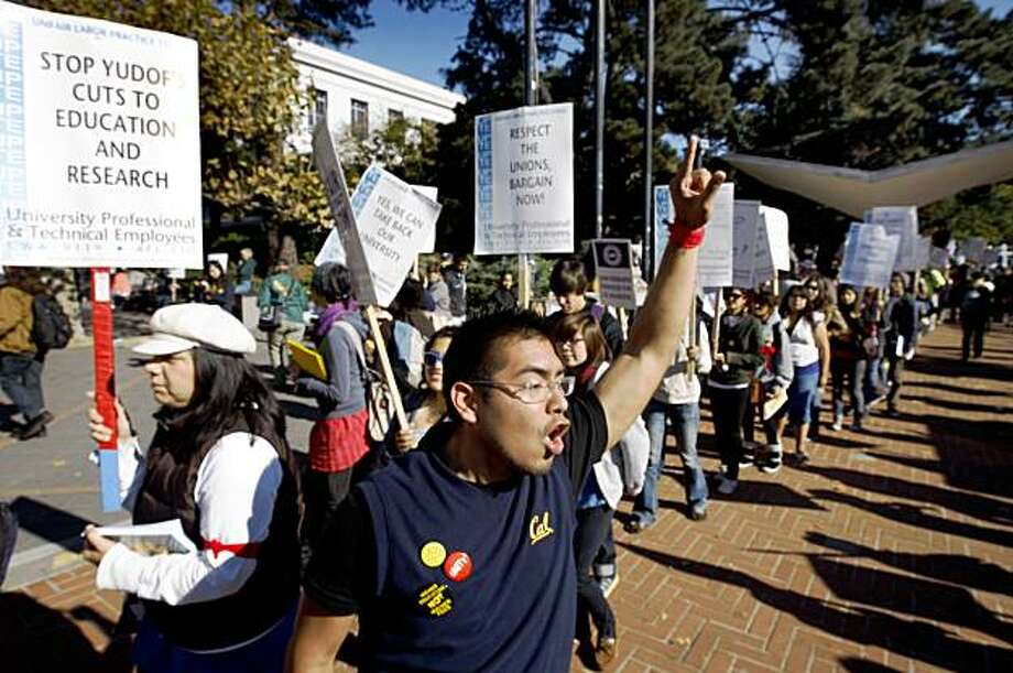 Student Uriel Rivera leads a chant for hundreds of UC Berkeley students, faculty and staff walking a picket line to oppose 32% hikes in students fees in Berkeley on Wednesday. Photo: Paul Chinn, The Chronicle