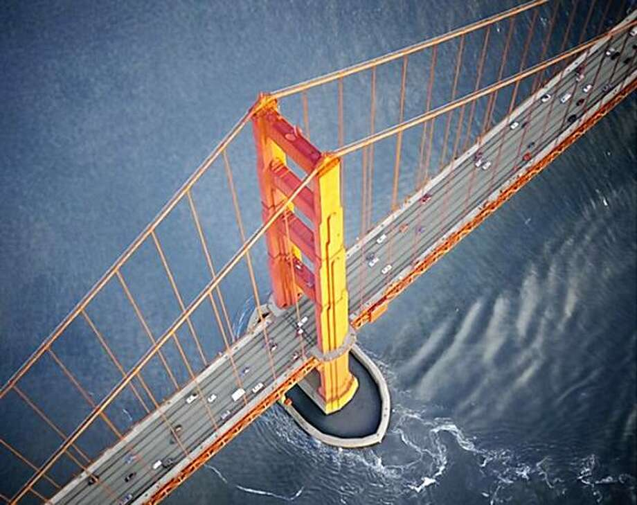 "One of Robert Cameron's most popular shots, taken in the early 1990's just west-and ""ABOVE""- the Golden Gate Bridge. Cameron died Tuesday, Nov. 10 at age 98. Photo: Robert Cameron"