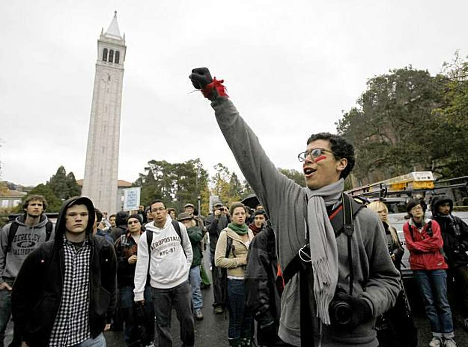 Students gather in front of the famed Campanile building on the University of California, Berkeley on the Berkeley, Calif., campus, Friday,. Nov. 20, 2009, during a demonstration against university  fee hikes and layoffs.  (AP Photo/Paul Sakuma) Photo: Paul Sakuma, AP