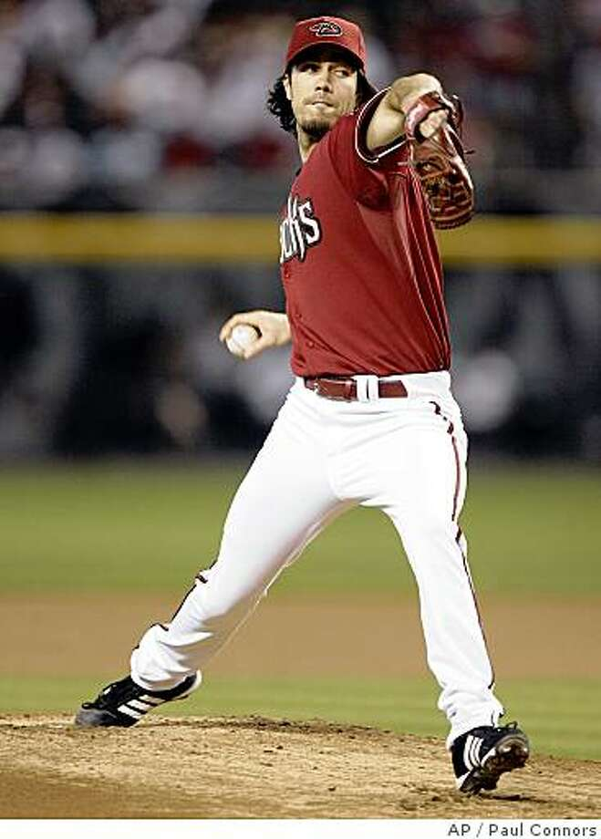 Arizona Diamondbacks' Dan Haren winds up to deliver a pitch against the Washington Nationals in the first inning of a baseball game Sunday, June 1,2008, in Phoenix.(AP Photo/Paul Connors) Photo: Paul Connors, AP