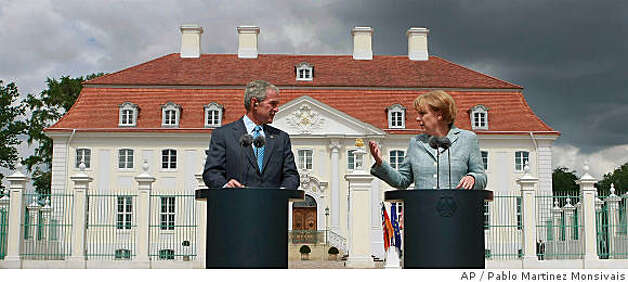 President Bush, left, and German Chancellor Angela Merkel, right, take part in joint news conference, Wednesday, June 11, 2008, at the Schloss Meseberg palace in Meseberg, Germany. (AP Photo/Pablo Martinez Monsivais) Photo: Pablo Martinez Monsivais, AP