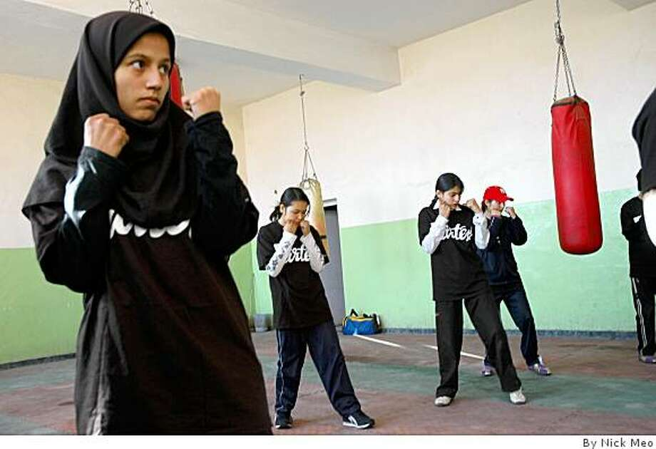 Afghan women train at the National Stadium in Kabul Photo: By Nick Meo