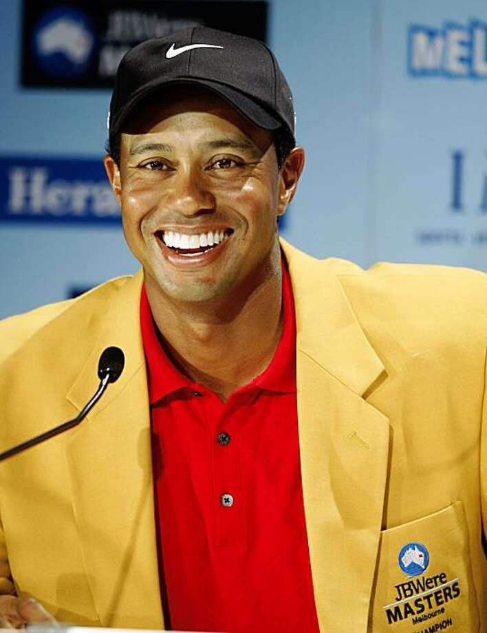 Wearing his new Australian Masters Gold jacket, Tiger Woods of the U.S. laughs at a humorous question in  Melbourne, Australia, Sunday, Nov. 15, 2009 during a post match press conference. Woods won the match with 14-under, two shots ahead of Australia's Greg Chalmers. (AP Photo/Rob Griffith) Photo: Rob Griffith, AP