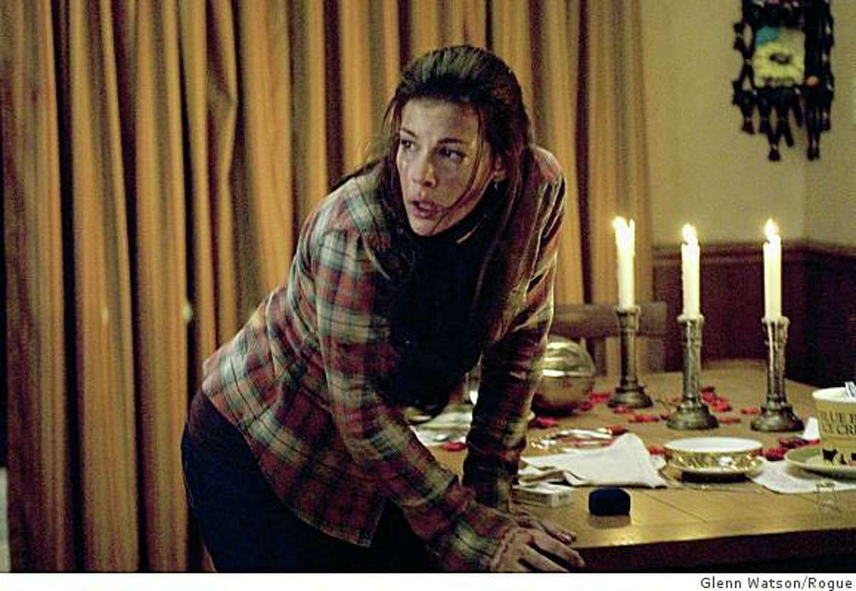 Kristen McKay (LIV TYLER) tries to escape her attackers in a terrifying suspense thriller about a couple whose remote getaway becomes a place of terror when masked strangers invade--'The Strangers'.