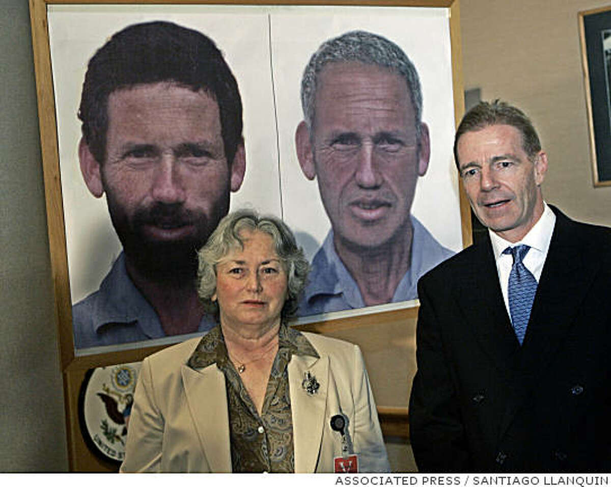 Olga Weisfeiler, left, sister of Eric Weisfeiler, an American mathematician missing in Chile since his arrest in 1985 by a military patrol, tells of her efforts to learn what happened to his brother during a press conference with U.S. Ambassador Craig Kelly, in Santiago, Chile, Friday, March, 31, 2006. Eric Weisfeiler is shown on the poster how he looked when he disappeared, left, and how he might look now. (AP Photo/Santiago Llanquin)