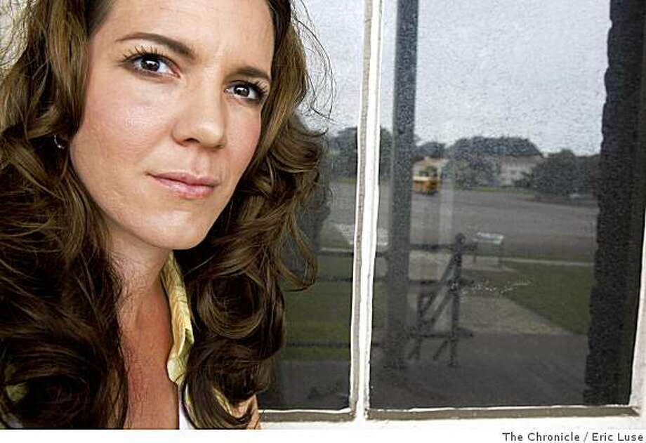 "At the old Presidio Army barracks with the Parade Grounds reflected in the window Author Zoe Ferraris has a new book out ""Finding Nouf"" recently moved back to the Presidio where she lived with her Army family until she was  19 years old photographed on Friday, May 30, 2008. Photo: Eric Luse, The Chronicle"