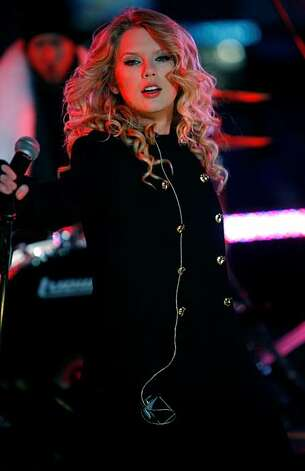 Taylor Swift performs during the New Year's Eve festivities in Times Square, New York, Wednesday, Dec. 31, 2008.  (AP Photo/Seth Wenig) Photo: Seth Wenig, AP
