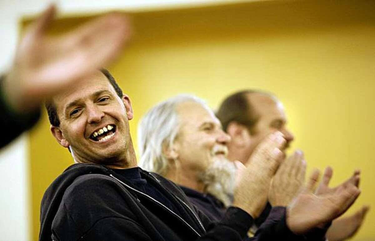 Jonathan Lee, 41 is an US Army veteran of the Iraq war and has been enrolled in the program since August 2009. Lee applauds as fellow vets and staff are singled out for praise during a community meeting on Friday November 06, 2009 in San Francisco, Calif. Veterans enrolled in the Swords to Plowshares, Transitional Housing Program, on Treasure Island.