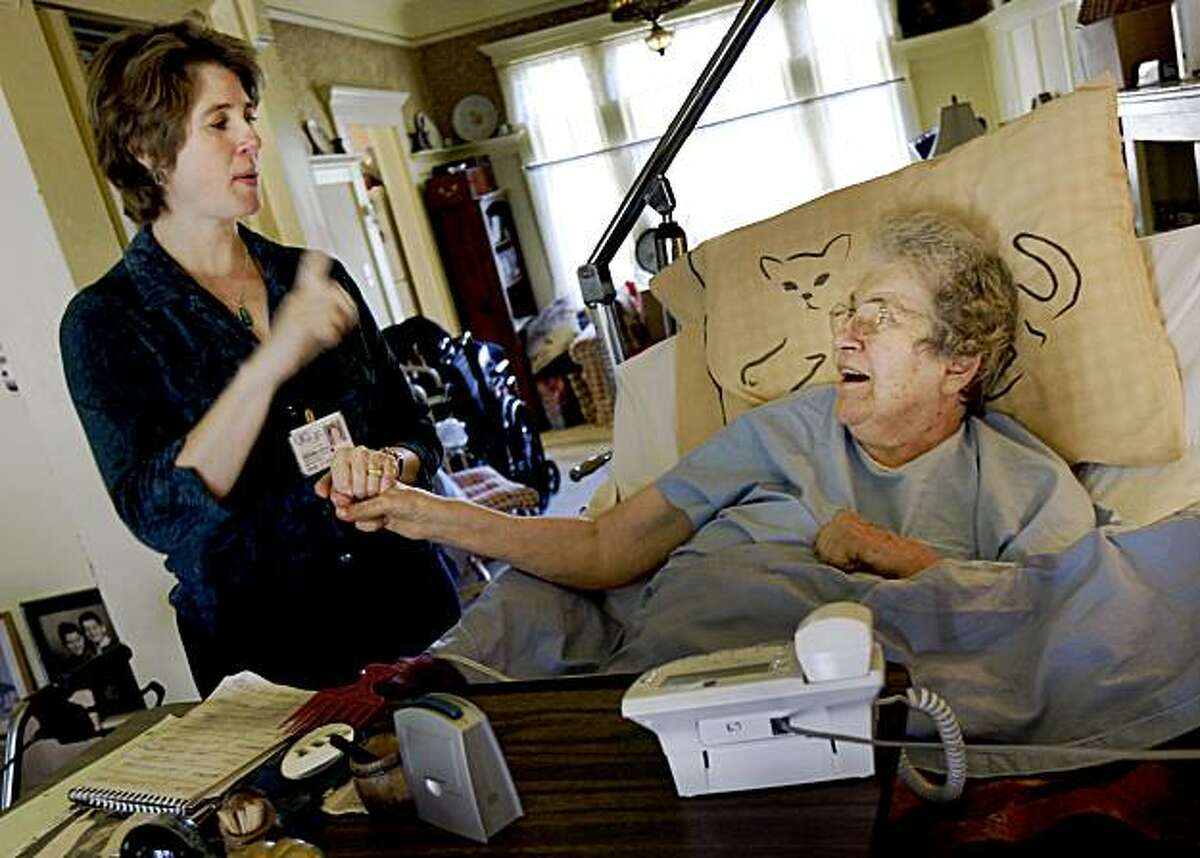 Dr. Conant (right) talks with June Hagosian during a housecall. June Hagosian, who lives with her husband Monte Sahagian, has a brain tumor and gets regular housecalls from UCSF and Dr. Rebecca Conant. The program now serves almost 100 patients in San Francisco.