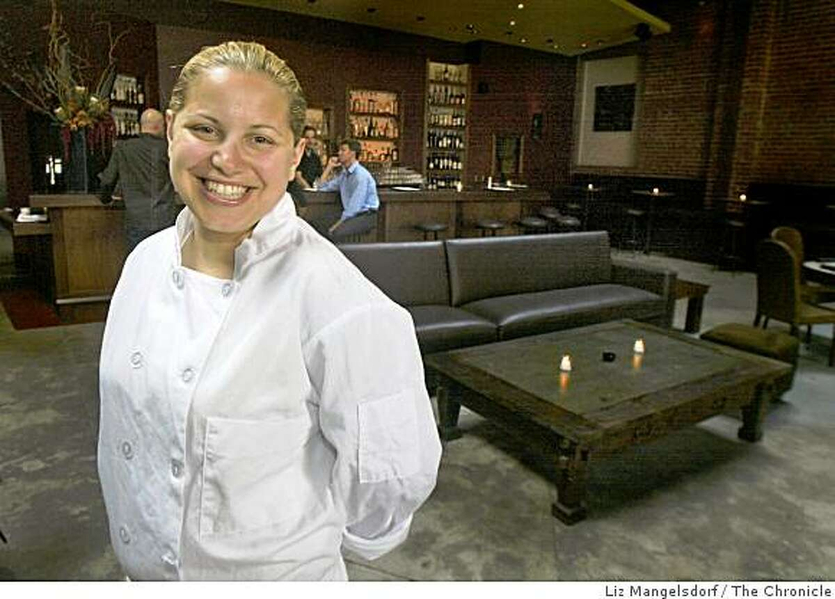 Executive Chef Jamie Lauren, in her restaurant Levende on Mission St. In the background is the bar and a leather sofa and coffee table. Liz Mangelsdorf / The Chronicle Ran on: 08-04-2004 Jamie Lauren heads the kitchen at Levende, a nightclub and small plates restaurant.