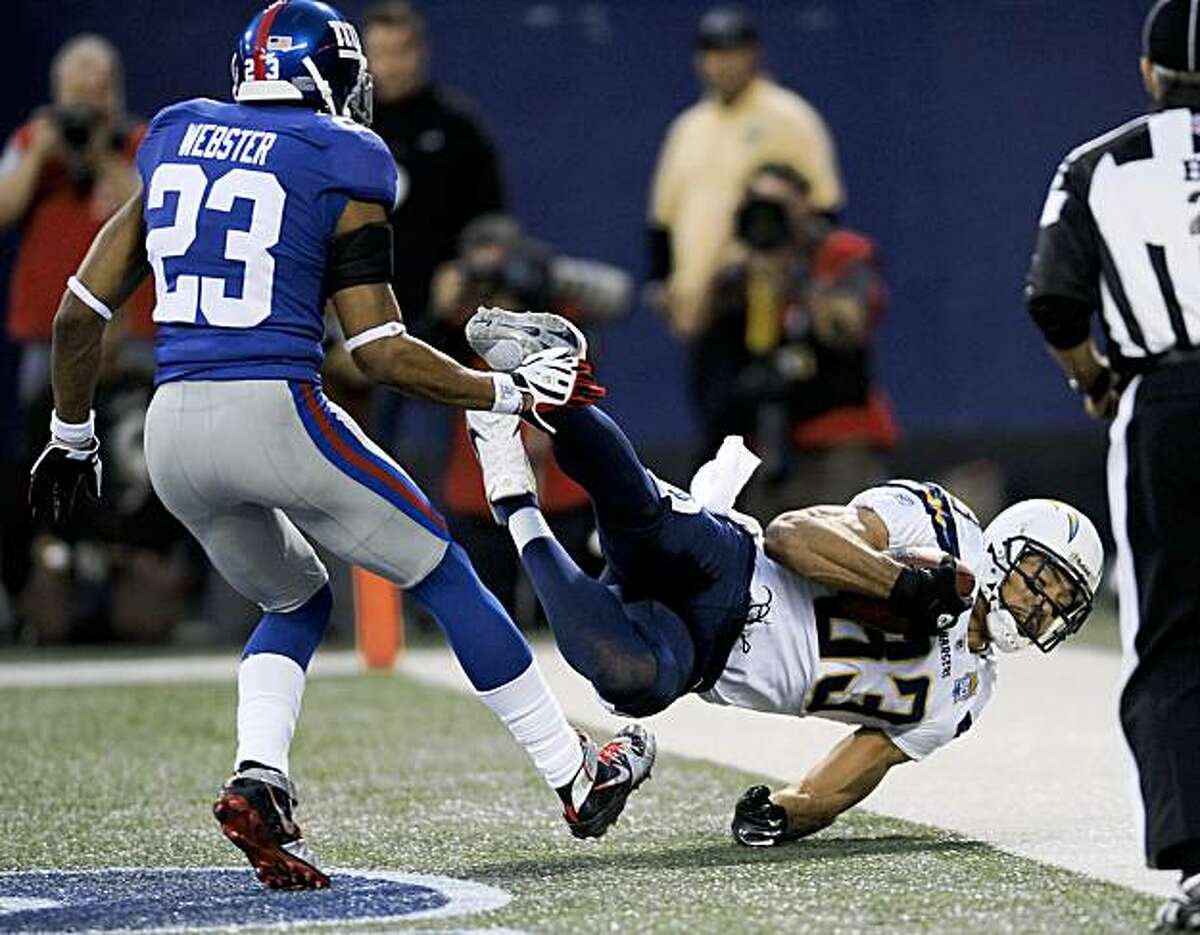 San Diego Chargers wide receiver Vincent Jackson (83) comes down with a pass for a touchdown despite the efforts of New York Giants cornerback Corey Webster (23) during the first quarter of an NFL football game, Sunday, Nov. 8, 2009 in East Rutherford, N.J. (AP Photo/Bill Kostroun)