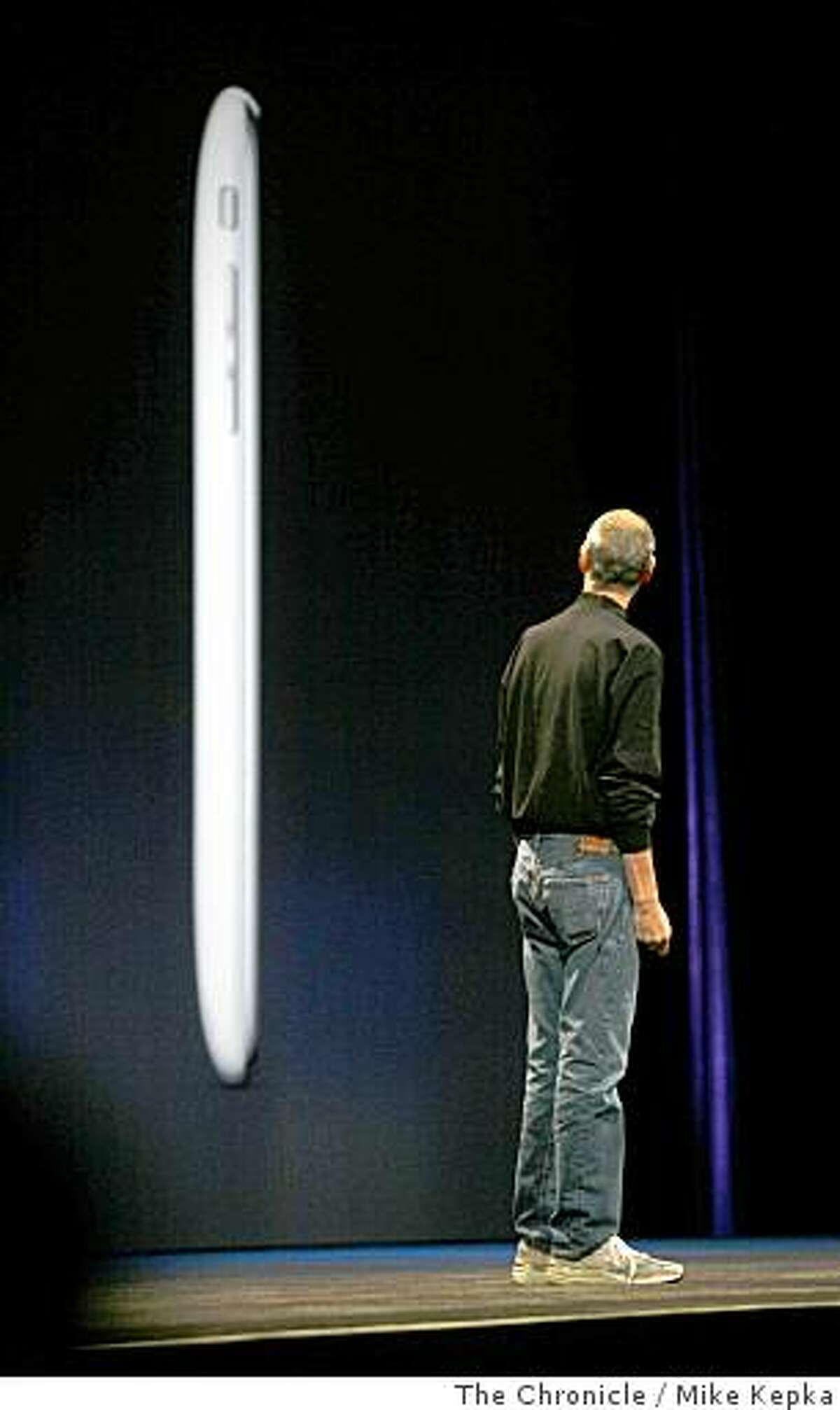 During the keynote address at this World Wide Developers Conference, Apple CEO Steve Jobs announces a new slimmer iPhone 3G on Monday, June, 9, 2008 in San Francisco, Calif. The new iPhone promises to be faster and cheaper then ever before with prices starting as low as $199. Photo by Mike Kepka / The Chronicle