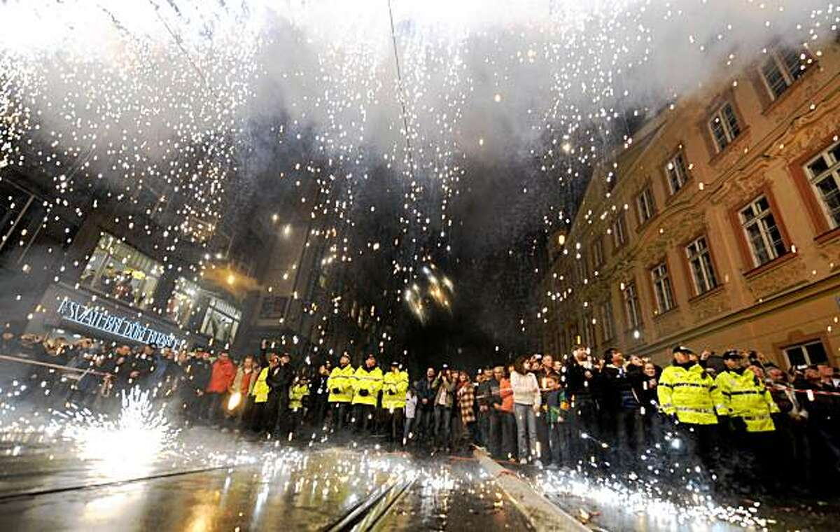 Czech people watch a symbolic iron curtain burning on Narodni trida in Prague in commemoration of the 20th anniversary of the Velvet Revolution, on November 17, 2009. Thousands of Czech citizens followed the same route taken by student demonstrators in 1989 until a violent intervention by riot police took place in what was then communist Czechoslovakia. The event in 1989 sparked a series of much larger protests and strikes that ended with in the relinquishing of power by the communist authorities in December of 1989, paving the way for the democratic election of a post-communist government under the leadership of then-President Vaclav Havel. AFP PHOTO/ JOE KLAMAR (Photo credit should read JOE KLAMAR/AFP/Getty Images)