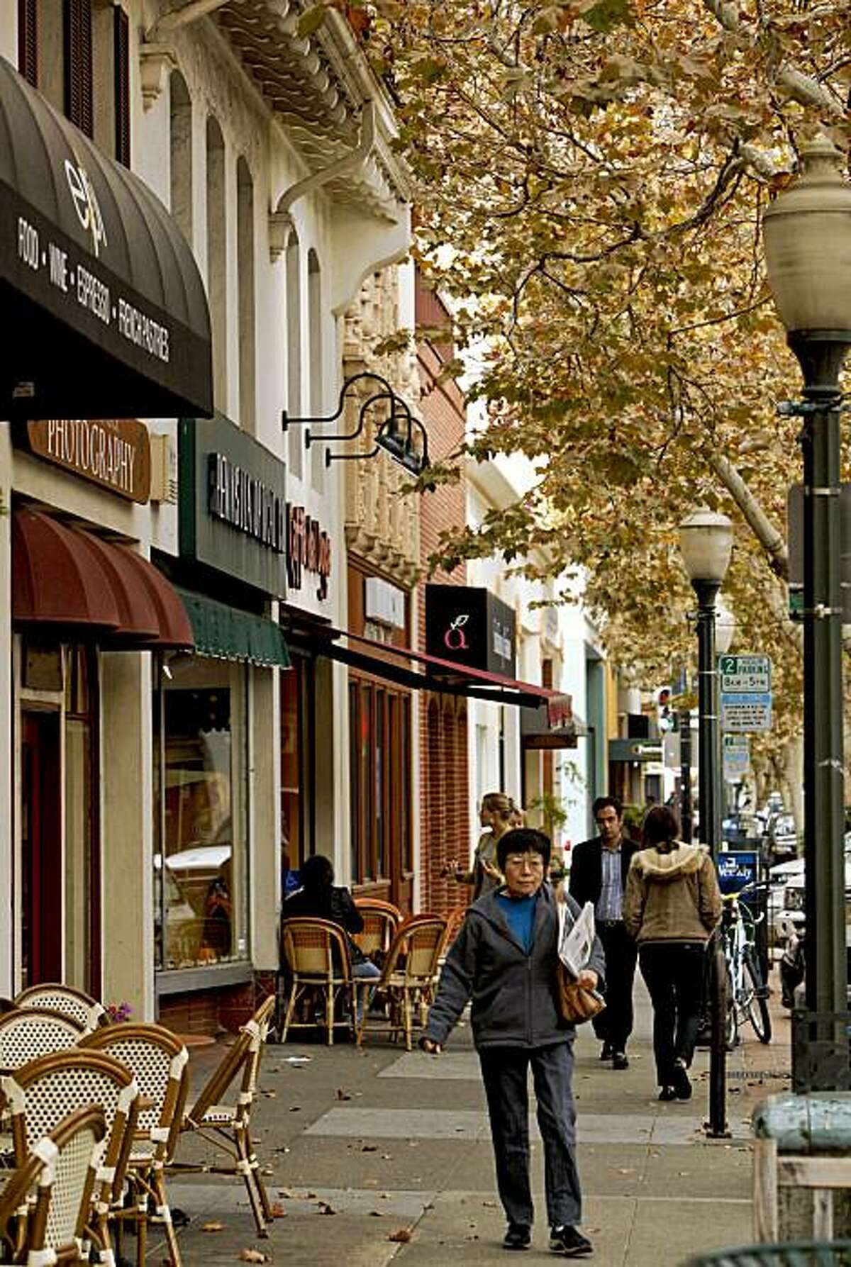 Tree-lined University Avenue's business district in Palo Alto is filled with small shops and sidewalk cafes.