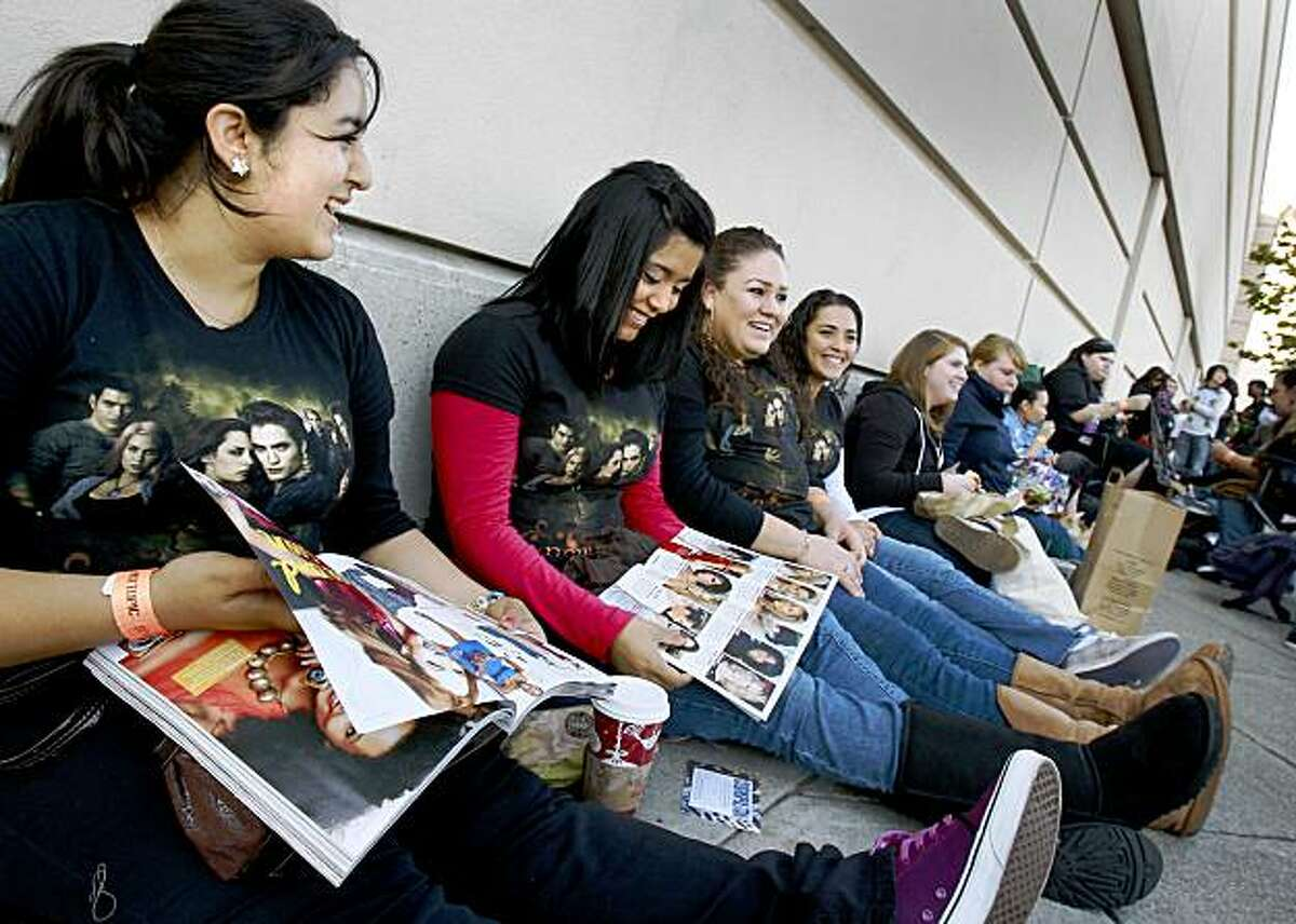 Paulina Ruiz (left) and her friends from Morgan Hill waited for hours for their opportunity to meet the stars. Hundreds of people waited outside the Stonestown Galleria Monday for a chance to see