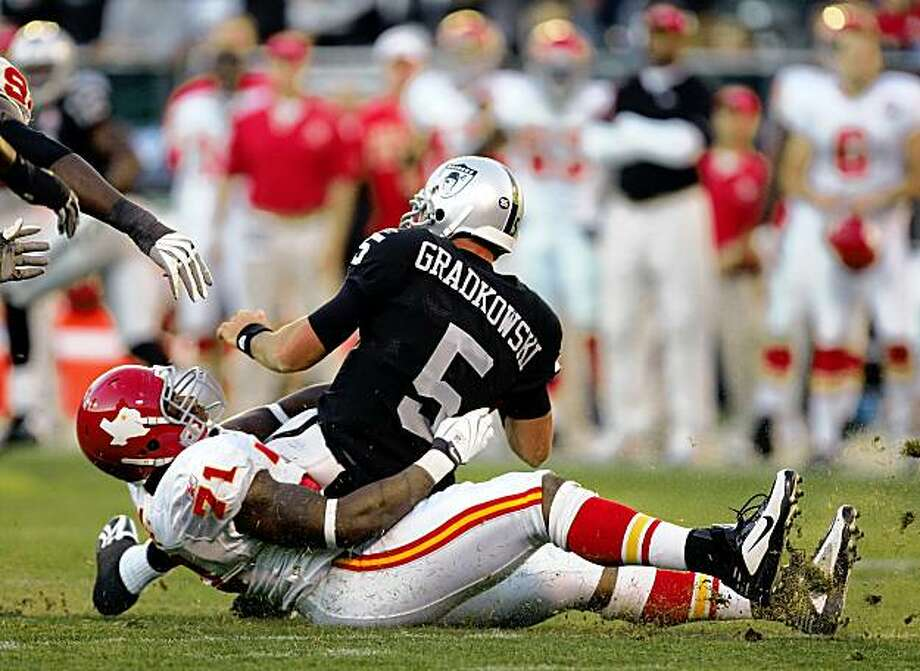 OAKLAND, CA - NOVEMBER 15:  Bruce Gradkowski #5 of the Oakland Raiders is sacked by Alex Magee #71 of the Kansas City Chiefs at Oakland-Alameda County Coliseum on November 15, 2009 in Oakland, California.  (Photo by Ezra Shaw/Getty Images) Photo: Ezra Shaw, Getty Images