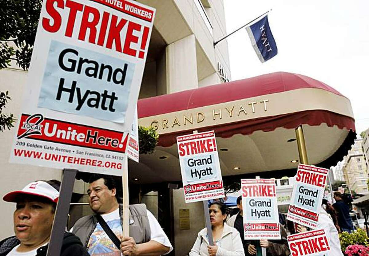 Grand Hyatt workers and supporters strike outside of the Grand Hyatt in the Union Square area of downtown San Francisco, Thursday, Nov. 5, 2009. Strike organizers say 300 Grand Hyatt workers plan a three-day strike over wages and benefits. Shares of Hyatt Hotels Corp. traded higher Thursday in the iconic hotel chain's first day on the New York Stock Exchange, with investors appearing to dismiss concerns about infighting among its founder's heirs and tepid hotel reservations around the world. (AP Photo/Paul Sakuma)