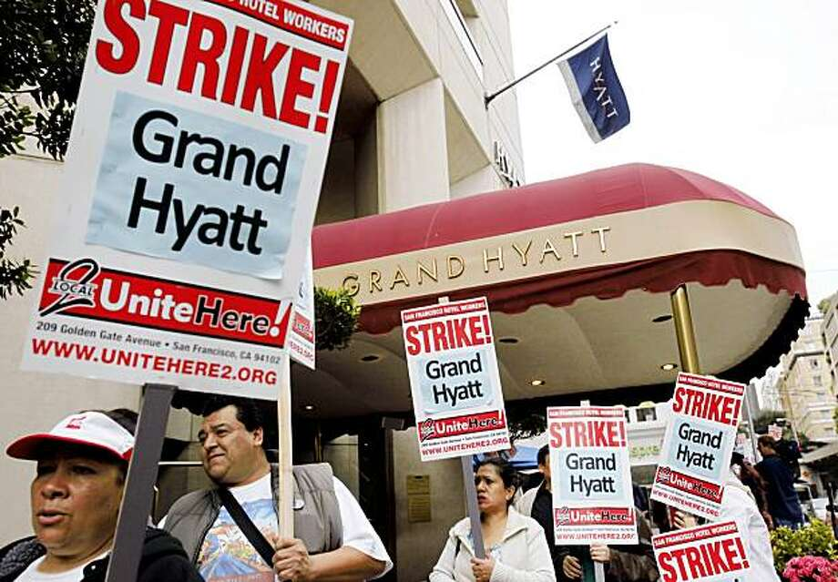 Grand Hyatt workers and supporters strike outside of the Grand Hyatt in the Union Square area of downtown San Francisco, Thursday, Nov. 5, 2009. Strike organizers say 300 Grand Hyatt workers plan a three-day strike over wages and benefits. Shares of Hyatt Hotels Corp. traded higher Thursday in the iconic hotel chain's first day on the New York Stock Exchange, with investors appearing to dismiss concerns about infighting among its founder's heirs and tepid hotel reservations around the world. (AP Photo/Paul Sakuma) Photo: Paul Sakuma, AP