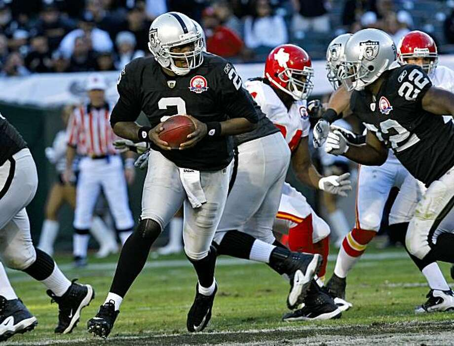Oakland Raiders  quarterback JaMarcus Russell hands off the ball to Gary Russell in a game against the Kansas City Chiefs, Sunday Nov. 15, 2009, in Oakland, Calif. Photo: Lacy Atkins, The Chronicle