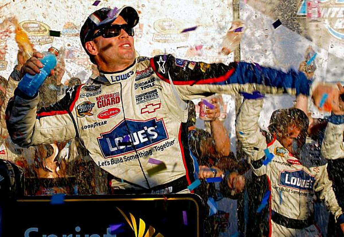 AVONDALE, AZ - NOVEMBER 15: Jimmie Johnson, driver of the #48 Lowe's Chevrolet, celebrates in victory lane after winning the NASCAR Sprint Cup Series Checker O'Reilly Auto Parts 500 at Phoenix International Raceway on November 15, 2009 in Avondale, Arizona. (Photo by Jason Smith/Getty Images for NASCAR)
