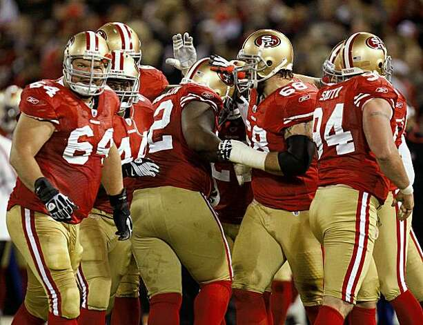 San Francisco 49ers players pat teammate Aubrayo Franklin (92) on the head after he intercepted the ball late in the second quarter against the Chicago Bears at Candlestick Park in San Francisco, California, Thursday, November 12, 2009. The 49ers defeated the Bears, 10-6. (Nuccio DiNuzzo/Chicago Tribune/MCT) Photo: Nuccio DiNuzzo, MCT