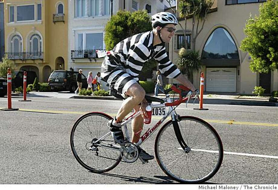 Dressed the part as an escaped convict, Morelle Bertrand of Santa Rosa, Calif., heads out on the 18 mile bike course of the Accenture Escape From Alcatraz Triathlon in San Francisco, Calif., on June 8, 2008. Athletes swim 1.5 miles from Alcatraz, bike 18 miles and then run 8 miles to complete the race.Photo by Michael Maloney / The Chronicle Photo: Michael Maloney, The Chronicle