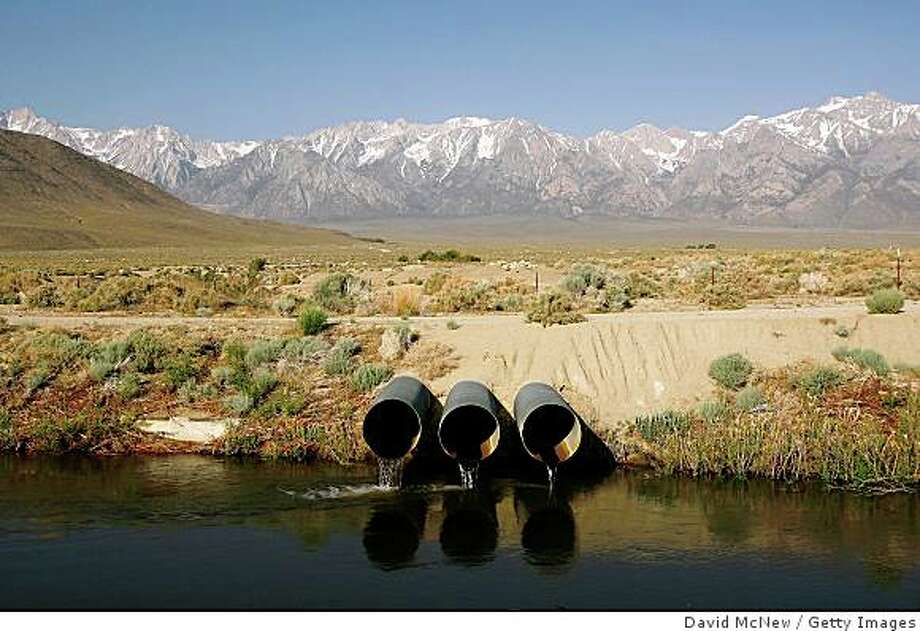 LONE PINE, CA - MAY 09:  The Los Angeles Aqueduct carries water from the snowcapped Sierra Nevada Mountains, which carry less snow than normal, to major urban areas of southern California on May 9, 2008 near Lone Pine, California. Urgent calls for California residents to conserve water have grown in the wake of the final Sierras snow survey of the season indicating a snow depth and water content at only 67 percent of normal levels. The Sierra snowpack is vital to California water supplies and officials are preparing plans for mandatory water conservation. In Southern California, the Metropolitan Water District, cut deliveries to farmers by nearly a third and growers in Fresno and Kings counties have not planted about 200,000 acres of crops, a third of the land irrigated by Westlands Water District. Many farmers are now selling their government-subsidized water for profit instead of using it to plant crops. Much of the California water supply comes from the Colorado River where a continuing eight-year drought has lowered water storage to roughly half of capacity. Dry conditions across the West have already doubled the wildfires this year causing fire officials to brace for a possible repeat of the devastating 2007 southern California wildfire season.  (Photo by David McNew/Getty Images) Photo: David McNew, Getty Images