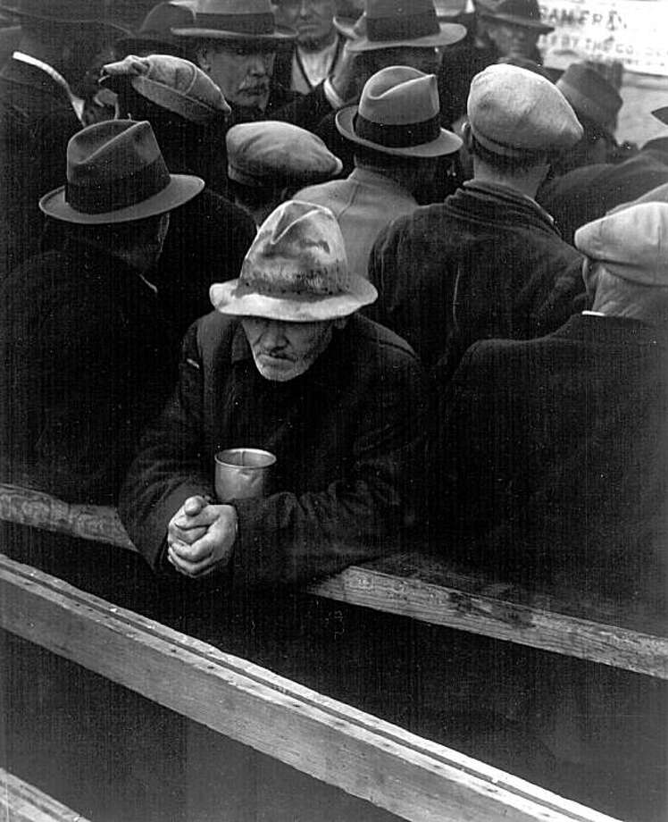 A man waits in a breadline in San Francisco in 1933, the year unemployment hit 24.9 percent. Photo: © The Dorothea Lange Collection, Oakland Museum Of California