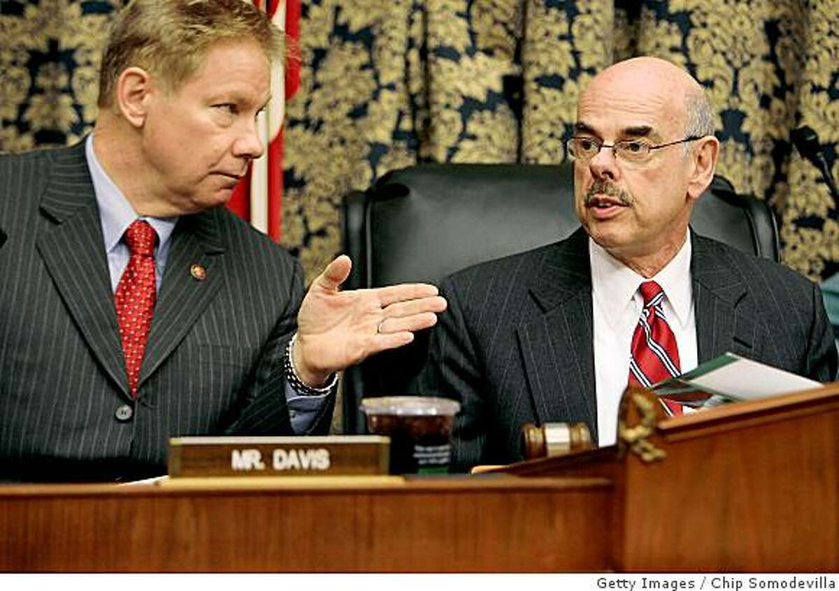 U.S. House Oversight and Government Reform Committee Chairman Henry Waxman (D-CA) (right) is expected to grill top finance industry executives about their compensation today. Rep. Tom Davis (R-VA) (left) called Waxman's inquiry a