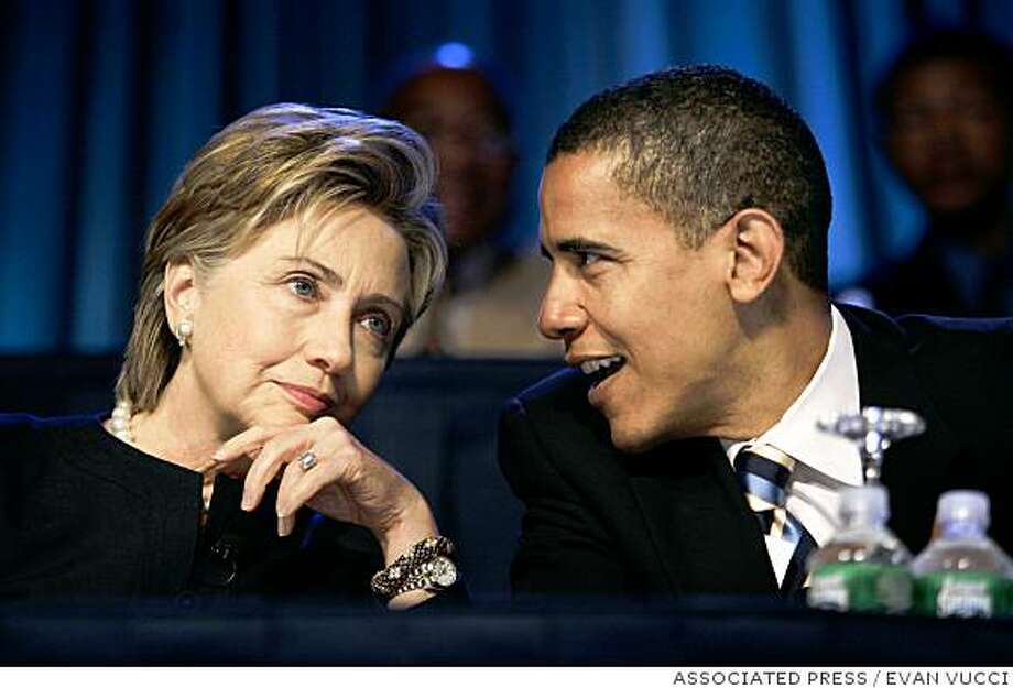 ** FILE ** In this July 19, 2006, file photo Sen. Hillary Rodham Clinton, D-N.Y., speaks with Sen. Barack Obama, D-Ill., right, during the annual convention of the National Association for the Advancement of Colored People in Washington, prior to their race for the Democratic presidential nomination. After Obama secured the nomination Tuesday, June 3, 2008, he called Clinton in the evening and left a message. Meanwhile, Clinton's aides and surrogates have pitched her for the No. 2 spot, though she has not officially ended her campaign.  (AP Photo/Evan Vucci, File ) Photo: EVAN VUCCI, ASSOCIATED PRESS
