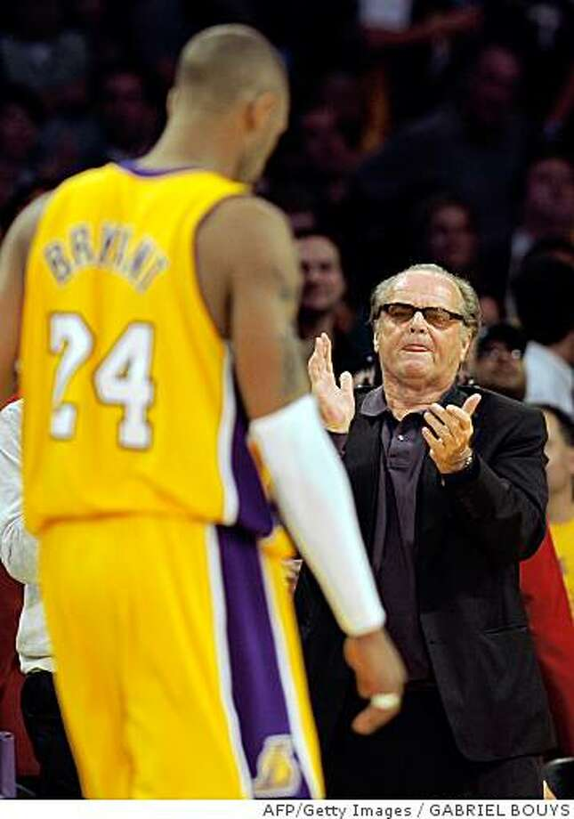 Los Angeles Lakers' fan and US actor Jack Nicholson applauds as Lakers' star Kobe Bryant walks off court at the end Game 4 against the Boston Celtics in the 2008 NBA Finals in Los Angeles, California on June 12, 2008.  The Celtics pulled off one of the greatest comebacks in National Basketball Association history, rallying from a 24-point hole to beat the 97-91 in the NBA Finals.  AFP PHOTO / GABRIEL BOUYS (Photo credit should read GABRIEL BOUYS/AFP/Getty Images) Photo: GABRIEL BOUYS, AFP/Getty Images
