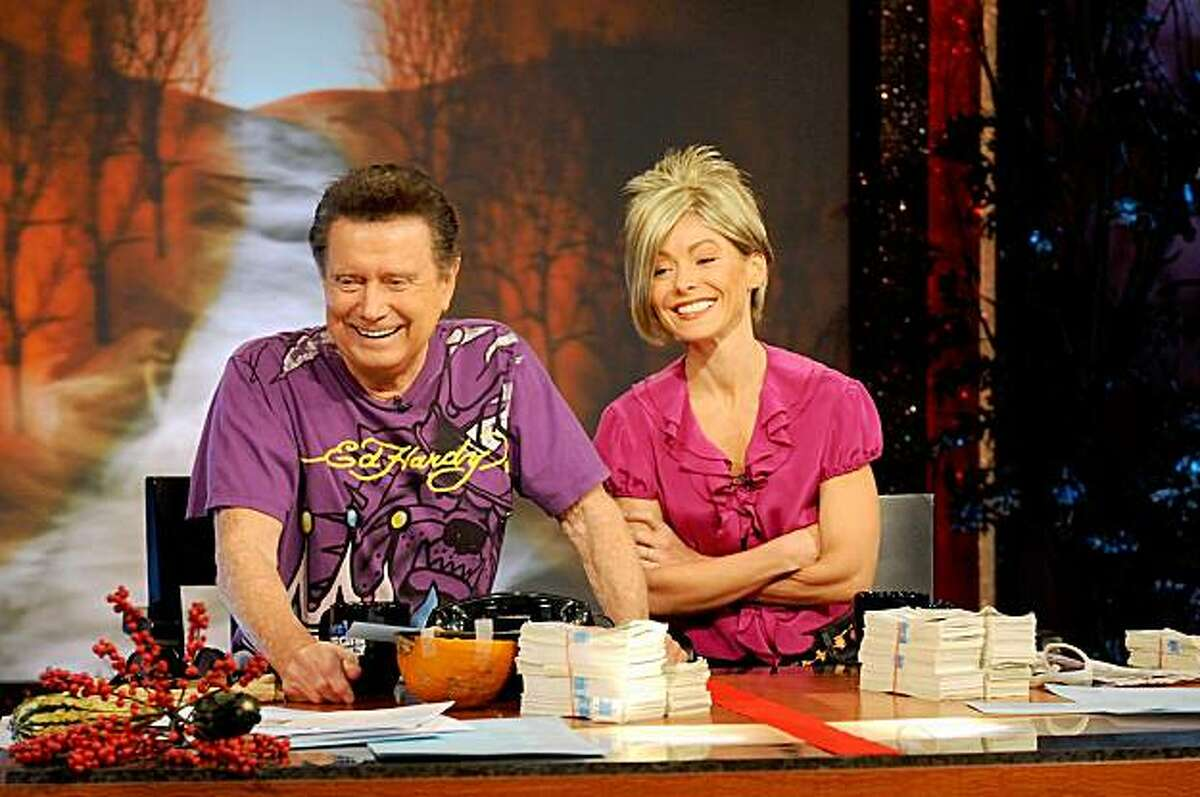 In this publicity image released by Disney-ABC Domestic Television, Regis Philbin, dressed as Jon Gosselin, left, and Kelly Ripa, dressed as Kate Gosselin from the TLC reality show,