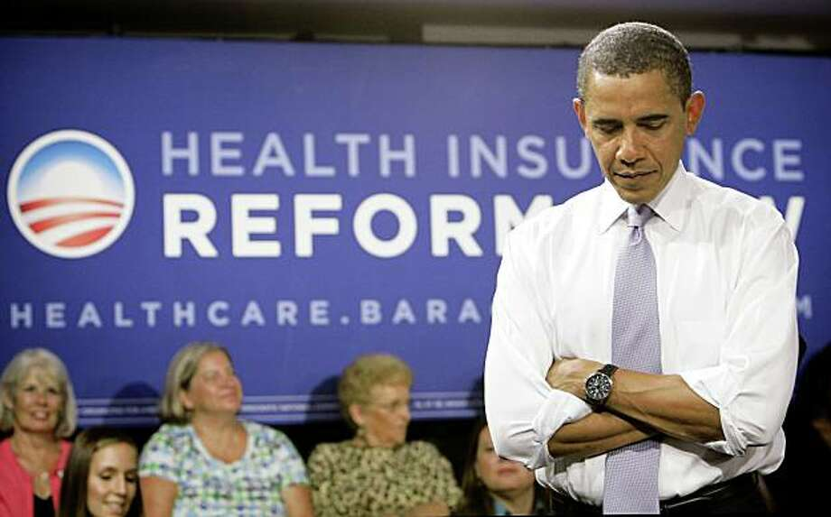 President Barack Obama listens to a question during the Organizing for America National Health Care Forum at the Democratic National Committee headquarters in Washington Thursday, Aug. 20, 2009.(AP Photo/Alex Brandon) Photo: Alex Brandon, AP
