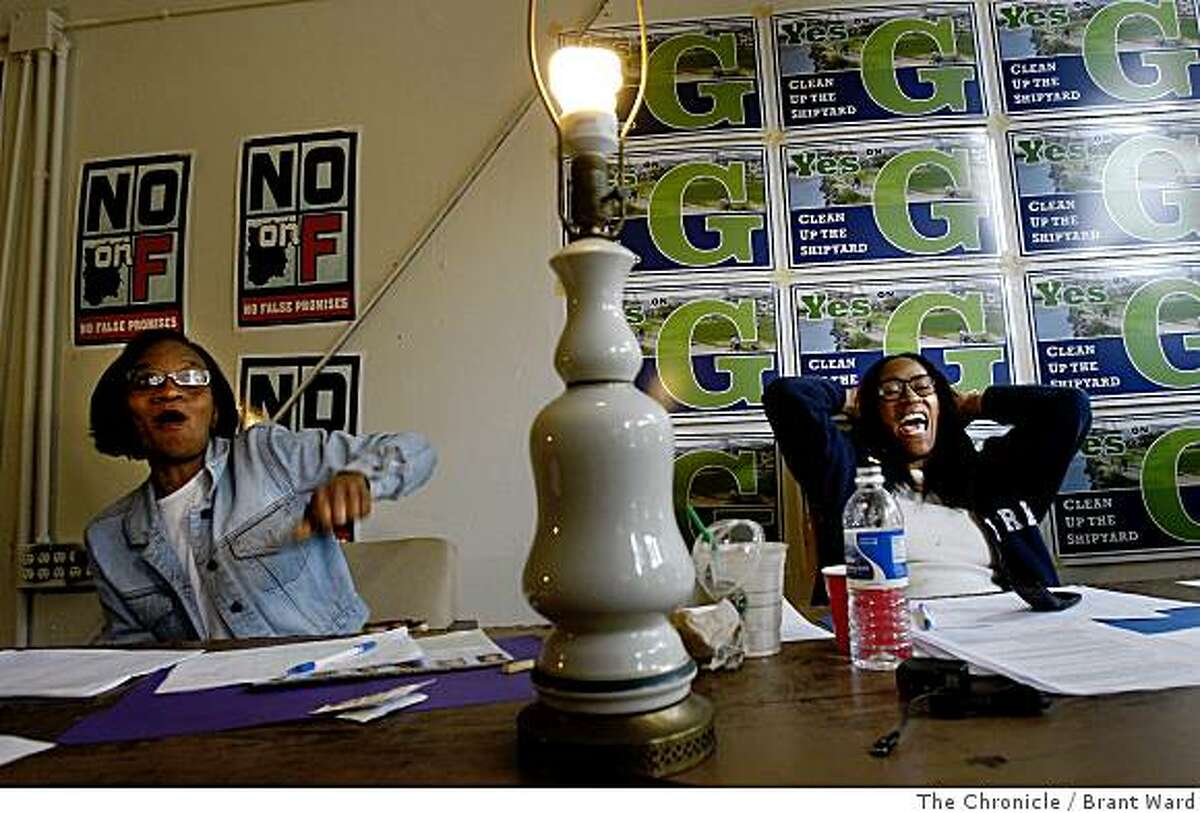 Pamala Hagler, left, and Sheila Harris react with joy after learning Barack Obama had won enough delegates for the Democratic nomination Tuesday while working at the Yes on G campaign. Photo by Brant Ward / The Chronicle