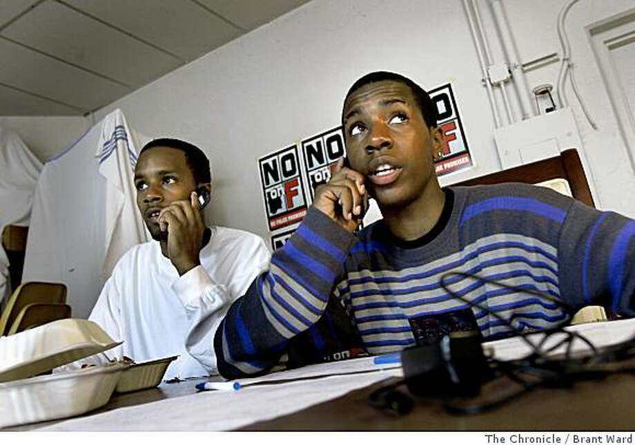 Brothers Brandon, left, and Jamal Jackson worked the phones to urging a yes vote on G and a no vote on F at a headquarters on Fillmore Street. Supporters of San Francisco, Calif. Propositions G and F worked Tuesday, June 3, 2008 to get out the vote. By Brant Ward / The Chronicle Photo: Brant Ward, The Chronicle