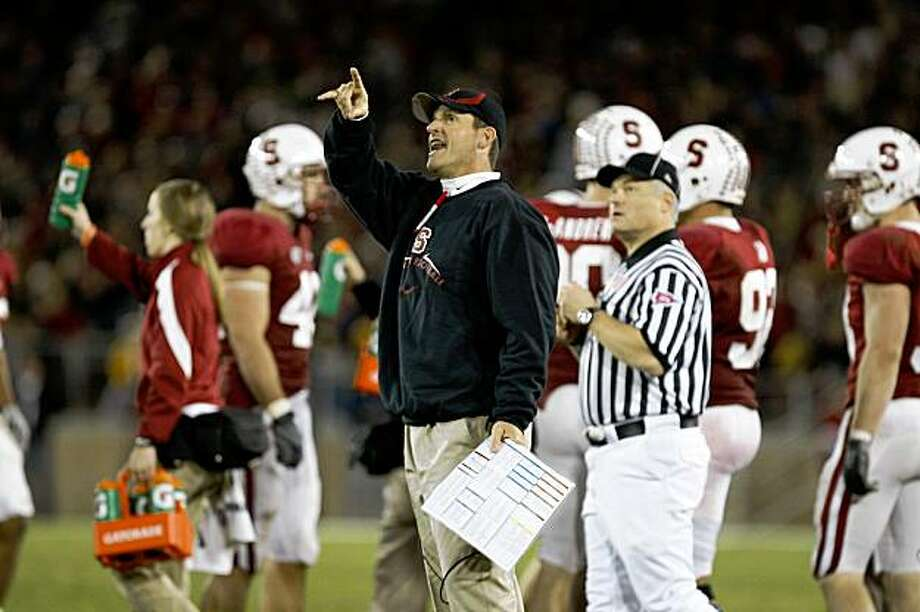 stanford coach JIm Harbaugh argues to get more time on the clock late in the 4th quarter in Big Game action as the Stanford Cardinal goes on  to loose to the California Golden Bears 34-28 in Palo Alto, Calif.  on Saturday November 21, 2009. Photo: Michael Macor, The Chronicle